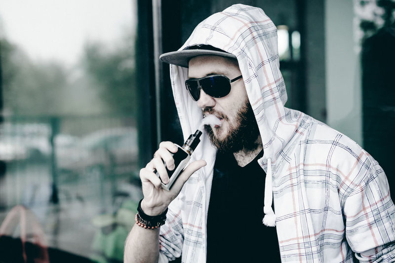 Vaping Bad Habit Close-up Day Focus On Foreground Holding Lifestyles One Person Outdoors Real People Sunglasses Vape Vapecommunity Young Adult
