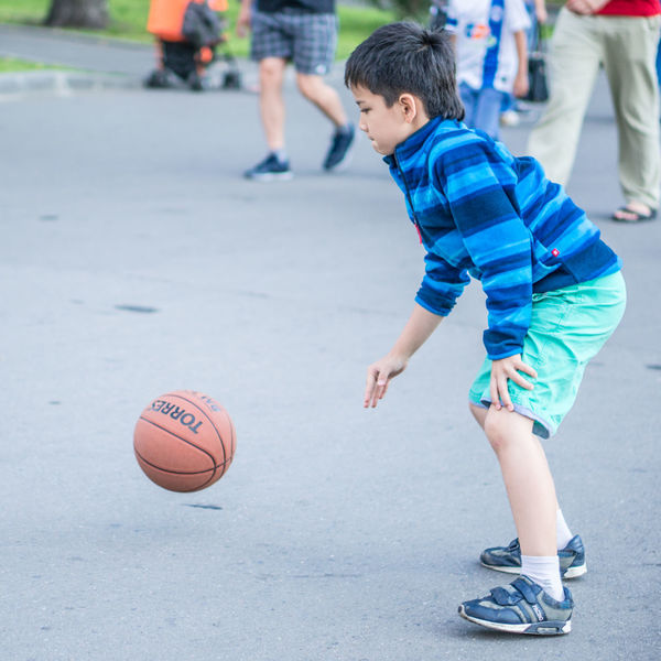 Boys Casual Clothing Childhood Cute Day Enjoyment Focus On Foreground Full Length Fun Leisure Activity Lifestyles Outdoors Playful Playing Running Skill  Sport