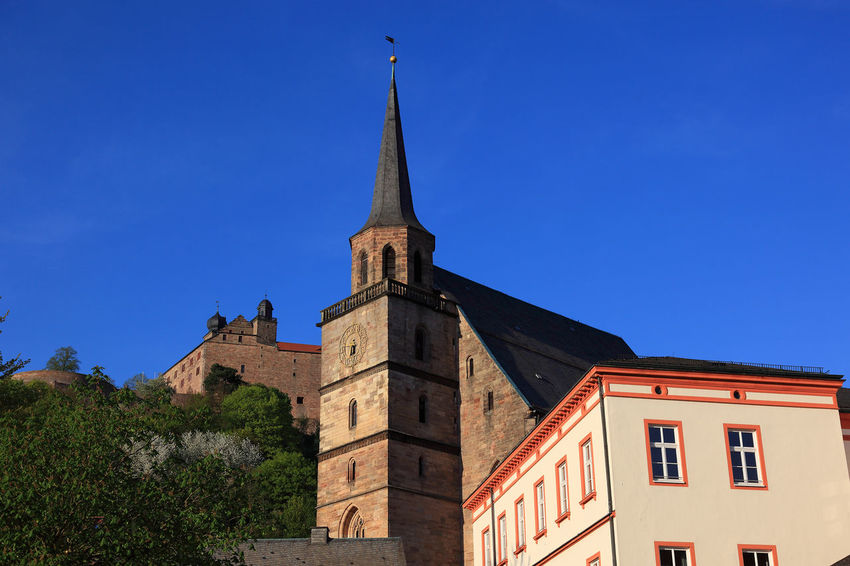 old city and castle Plassenburg and church Petrikirche of Kulmbach, Frankonia, Bavaria, Germany Plassenburg Architecture Belief Blue Building Building Exterior Built Structure Clear Sky Clock Day Kulmbach Low Angle View Nature No People Outdoors Place Of Worship Religion Sky Spire  Spirituality Tower Tree