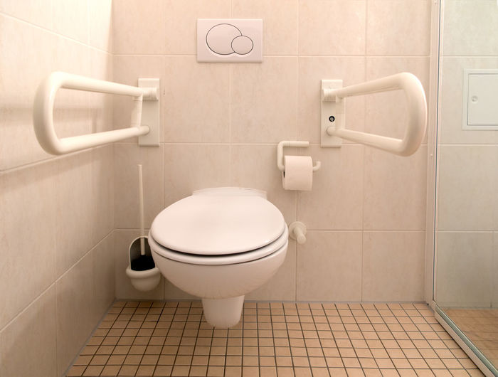 Restroom for disabled people Architecture Bathroom Clean Cloakroom Disabled Domestic Bathroom Domestic Room Flushing Toilet Grab Bar Hygiene Indoors  Modern No People Physical Impairment Public Restroom Railing Room Sanitary Tile Tiled Floor Toilet Toilet Bowl Toilet Paper Toilet Seat