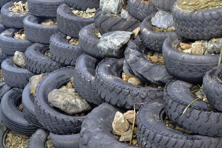 creative way of used tyres Black Color Creative Creative Shots Creativity Creativity Has No Limits Day No People Outdoors Pattern, Texture, Shape And Form Patterns & Textures Patterns In Nature Rock Rock - Object Rocks And Water Sea Side Fort Tire Tyre Tyres Used