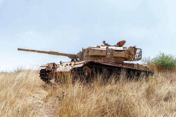 Destroyed Israeli tank is after the Doomsday (Yom Kippur War) on the Golan Heights in Israel, near the border with Syria Action Arab Armor Armored Army Attack Battle Battlefield Blue Border Cannon Color Combat Concept Conflict Country Danger Defense Design East Fighter Forces Golan Heights Gun Israel Israeli Jewish Maneuver Middle Military Mountain Nature People Power Rifle Scenery Security Sky Soldier Syria  Syrian Tank Terror Turret Valley Vehicle War Weapon Yom Kippur War Zone