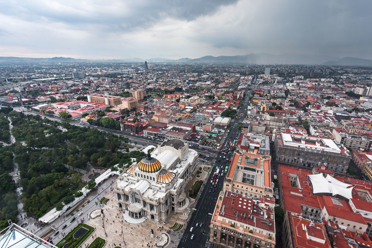 Aerial view of the Fine Arts Palace in Mexico city. Downtown Storm Aerial View Architecture Building Building Exterior Built Structure City Cityscape Cloud - Sky Crowd Crowded Day High Angle View Nature Outdoors Palacio De Bellas Artes  Residential District Roof Settlement Sky Street Town TOWNSCAPE Urban Sprawl