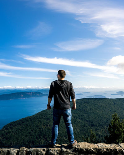 One Person Sky Scenics - Nature Standing Cloud - Sky Beauty In Nature Leisure Activity Full Length Day Men Nature Mountain Looking At View Vacations Outdoors Real People Hiking Lifestyle Orcas Island Washington State Summer Casual Non-urban Scene Menswear Blue Sky