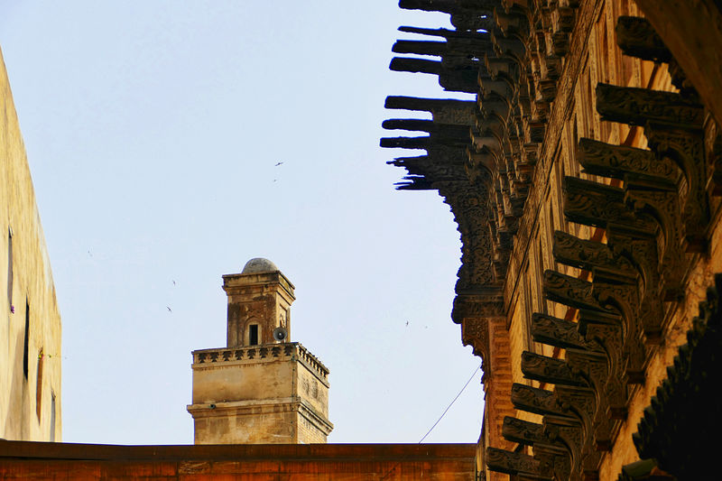 Low angle view of old buildings against clear sky
