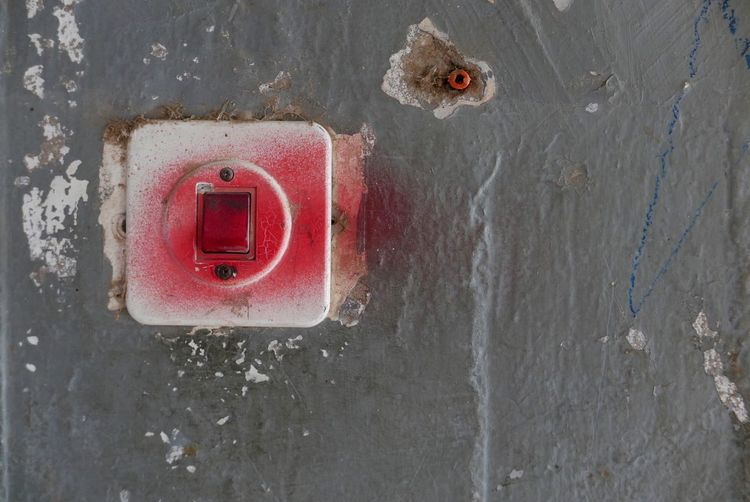Social Issues Light Switch Red No People Wall - Building Feature Close-up Day Old Textured  Concrete