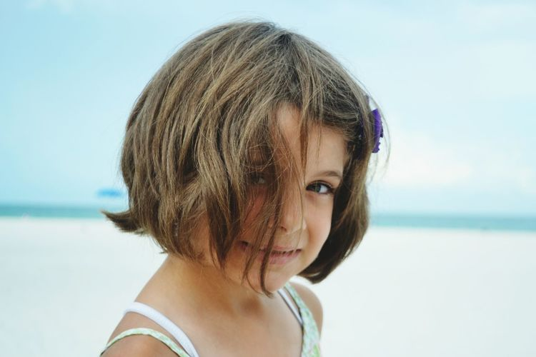 Close-up portrait of girl on the beach
