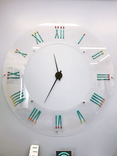 EyeEm Selects A large clock with toothbrushes for numerals in a dentist's waiting room. Time Clock White Color Minute Hand No People Indoors  Clock Face Close-up Roman Numeral Multi Colored Hour Hand Day Toothbrush Toothbrushes Dentist