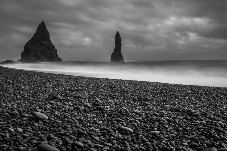 Reynisfjara Beach Beauty In Nature Blackandwhite Photography Cloud - Sky Day Horizon Over Water I Nature No People Outdoors Pebble Pebble Beach Reynisdrangar Reynisfjara Scenics Sea Sky The Great Outdoors - 2017 EyeEm Awards Tranquility Water Lost In The Landscape