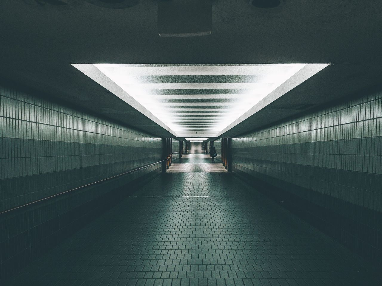 Empty subway along tiled wall