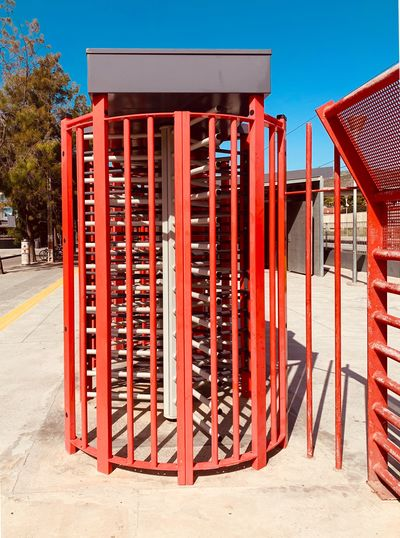 Red metallic structure against clear blue sky