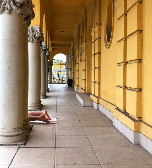 Feet at the Bath Feet Yellow Baths Architecture Built Structure Building Day Real People Arcade A New Perspective On Life Travel Destinations Architectural Column Corridor
