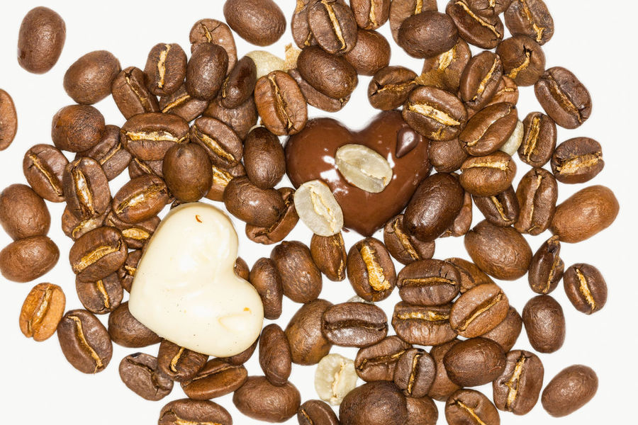 Close Up Of Two Pieces Of Chocolate And Coffee Beans On A White Background Beans Blackandwhite Brown Chocolate Close-up Coffee Coffee Background Coffee Time Decoration Food Food And Drink Freshness Gift Healthy Eating Love Love ♥ Mix No People No People, Party Raw Seed Studio Unprocessed White Background