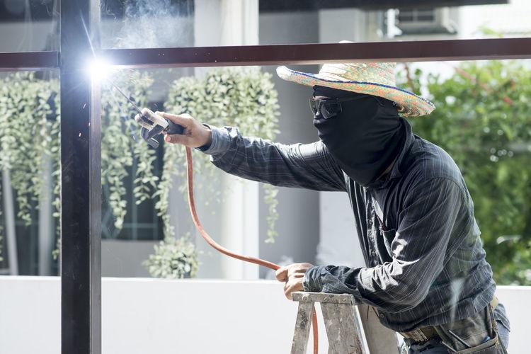 Welder welding metal
