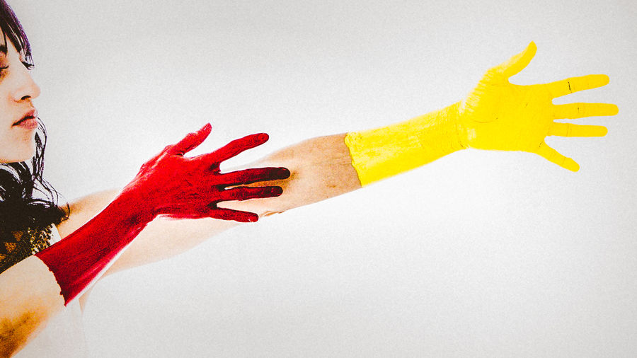 Close-up of human hand against red background