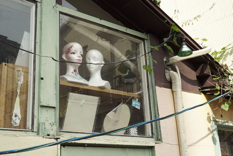 Low angle view of statues on abandoned building