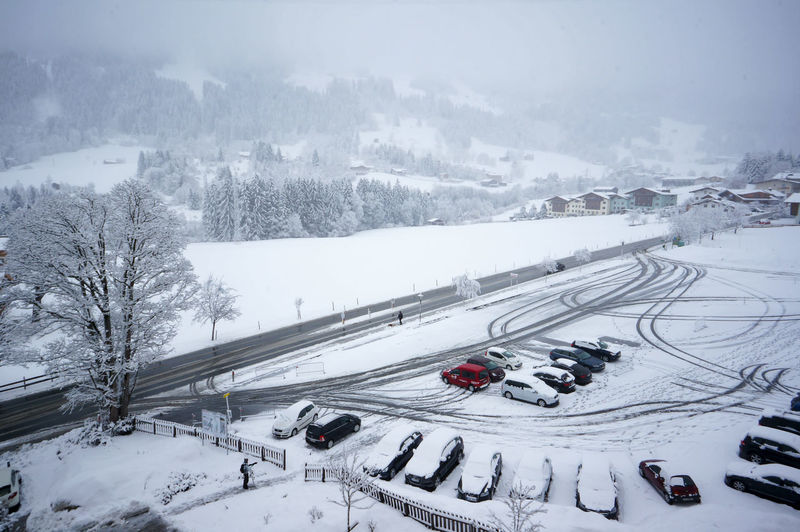 High Angle View Of Cars On Snow Covered Field