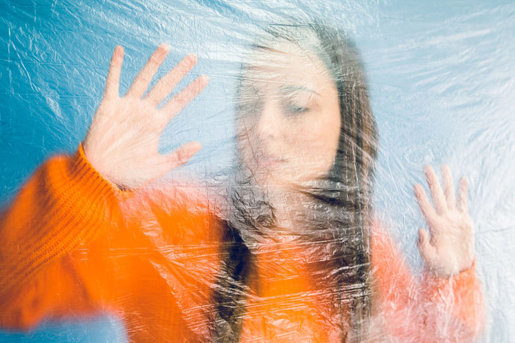 Thoughtful teenage girl trapped in plastic