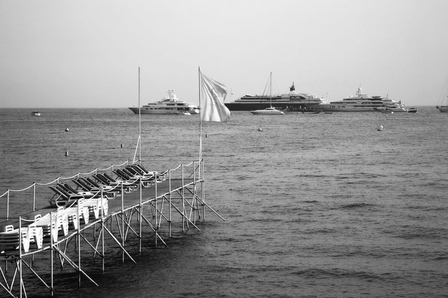 Yachts in the bay of Cannes Bay Beach Black & White Black And White Black And White Photography Blackandwhite Blackandwhite Photography Cannes CannesFilmFestival Clear Sky Day Horizon Over Water Luxury Luxurylife Mediterranean Sea Nature Nautical Vessel No People Outdoors Pier Sea Sky Transportation Yacht Yachting