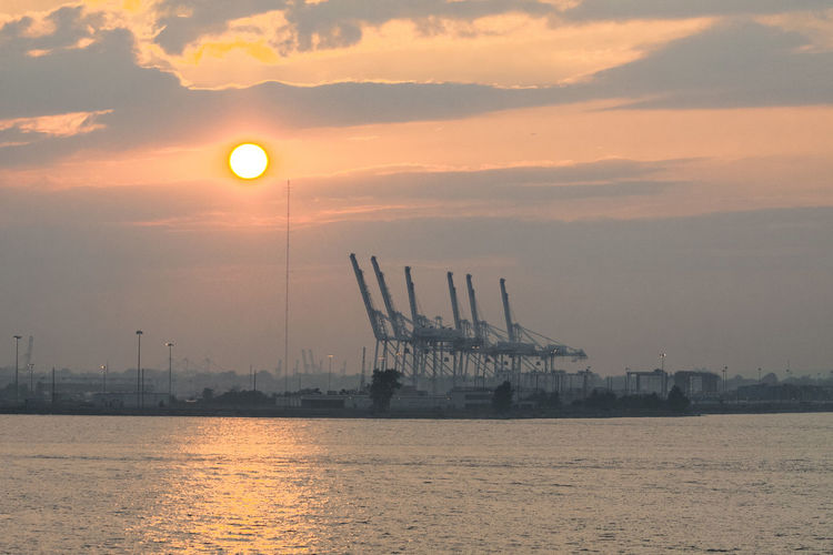 NY Water Sunset Sky Waterfront Cloud - Sky Industry Sea Crane - Construction Machinery Machinery Sun Transportation Nature Nautical Vessel Scenics - Nature Freight Transportation No People Shipping  Beauty In Nature Architecture Harbor Outdoors Construction Equipment