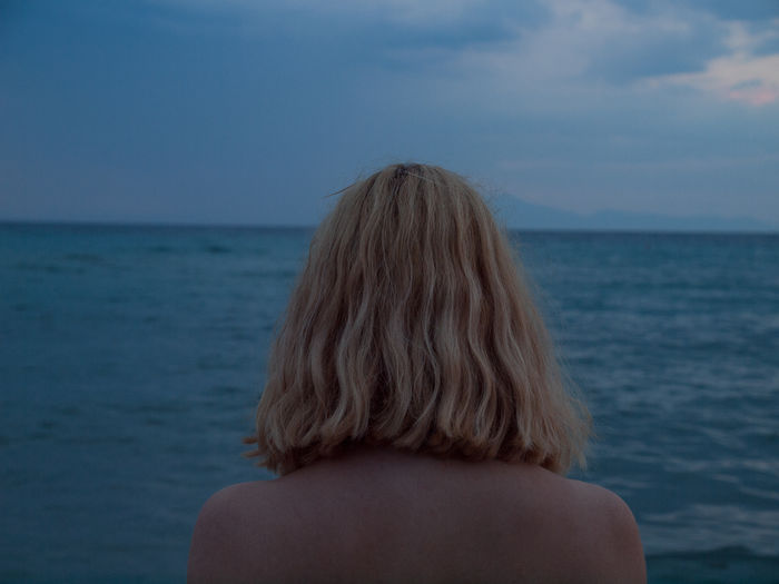 Listen to the voice of the sea. Melancholic Landscapes Adult Blond Hair Clouds Gloomy Grey Tones Hair Hairstyle Headshot Horizon Horizon Over Water Human Hair Long Hair Melancholy Moody Nature Ocean One Person Sea Seascape Sky Water Waterfront Women