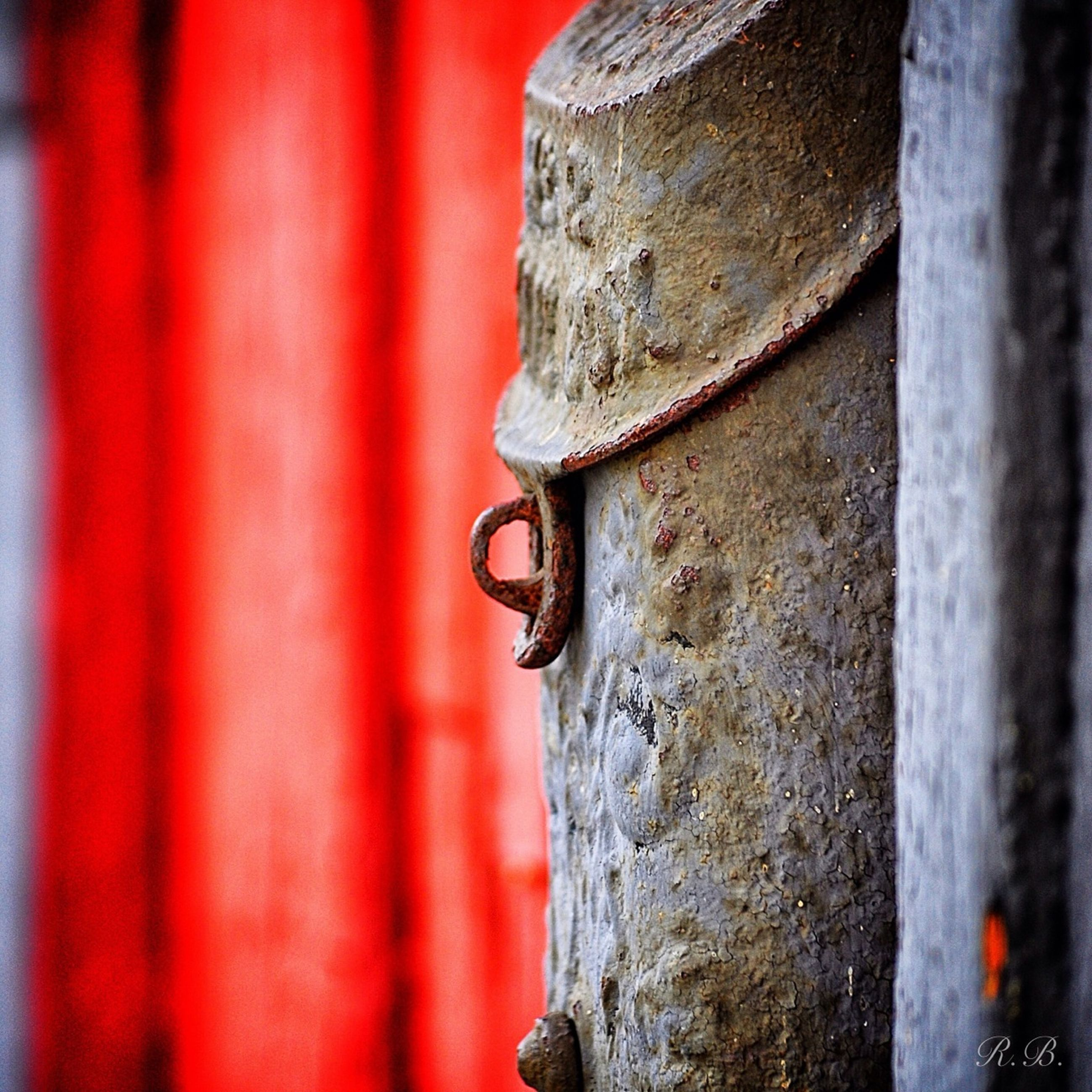 textured, close-up, weathered, old, red, focus on foreground, built structure, architecture, wall - building feature, history, rough, day, outdoors, detail, no people, selective focus, building exterior, low angle view, stone material, part of