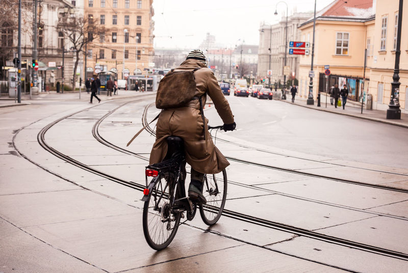 Pedaling in Vienna. Shadesofwinter Shades Of Winter Travel Streetphotography Winter Cold Real People Bicycle Transportation Building Exterior Built Structure Architecture Mode Of Transport City Day Outdoors Riding One Person Full Length The Street Photographer - 2018 EyeEm Awards The Traveler - 2018 EyeEm Awards