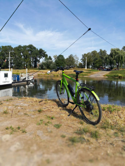 ....an der Fähre bei Polle. Ebike Stromer Pedelec E-bike Polle Weser Weser River Weserbergland Ferry Ferryboat Niedersachsen Tree Water Lake Bicycle Nautical Vessel Stationary Cable Sky Cloud - Sky Bicycle Rack