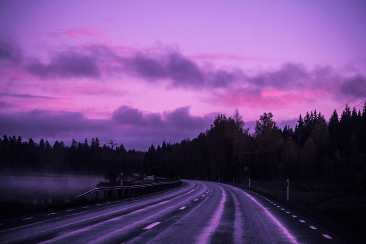 Panoramic view of road against sky at sunset