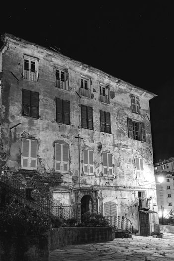 Low angle view of old building at night