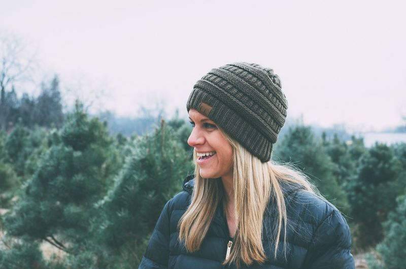 Ever green The Week on EyeEm Eye4photography  EyeEm Best Shots Smiling Clothing Real People One Person Happiness Lifestyles Warm Clothing Hat Winter Nature Women Portrait Happiness Hat Knit Hat Hair Headshot Looking Away Long Hair Young Women Nature
