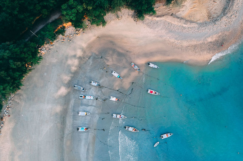 Aerial View Of Boats Moored On Shore At Beach