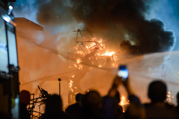 Crowd against fire at night