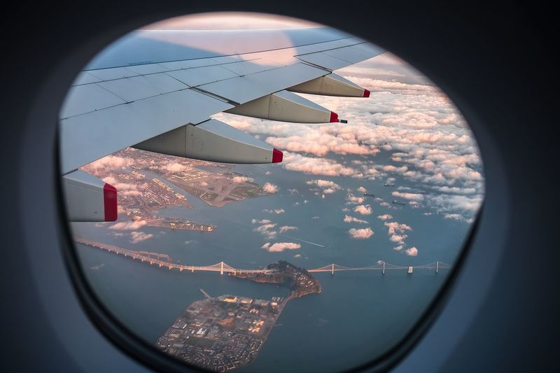 Aerial view of san franciscooakland bay bridge seen from airplane window