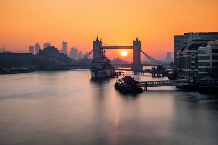 Sunrise behind the iconic Tower Bridge in London, UK Architecture Built Structure Building Exterior Sky Transportation City Water Sunset Bridge Travel Destinations River Bridge - Man Made Structure Waterfront Travel Tourism Skyscraper Connection Reflection No People Cityscape London Sunrise Thames River United Kingdom Tower Bridge  Skyline Long Exposure Tourist Attraction  Travel Landmark