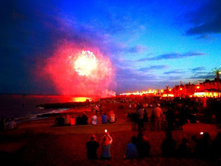Fireworks onthe Beach Armed Forces Day Fireworks Beach People Watching Large Group Of People Celebration Exploding Illuminated Firework Display Sky Crowd Outdoors Sky And Clouds Sea And Sky Seafront View