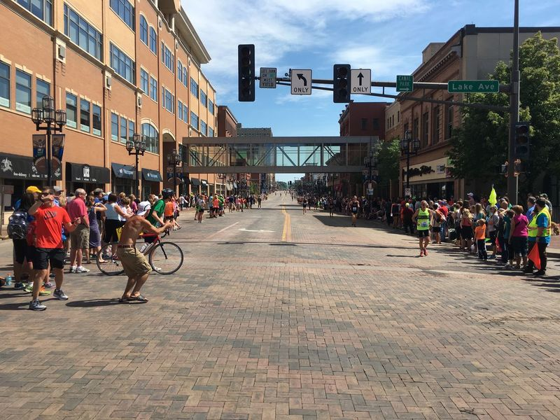 June 18, 2016 Architecture Building Building Exterior Built Structure City City Life City Street Cloud Cloud - Sky Crowd Day Diminishing Perspective Duluth Grandma's Marathon Large Group Of People Leisure Activity Lifestyles Minnesota Mixed Age Range Outdoors Sky The Way Forward Travel Destinations