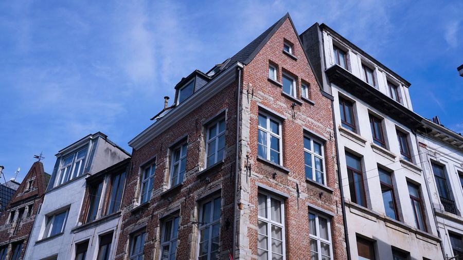 Corner Building Facades Old Architecture Street Sunlight Antwerp Downtown Rooftops Brick Building Old Buildings Copy Space Old Houses Architecture Built Structure Building Exterior Low Angle View Sky Window No People Building Cloud - Sky City Sunlight Glass - Material Day Outdoors Blue
