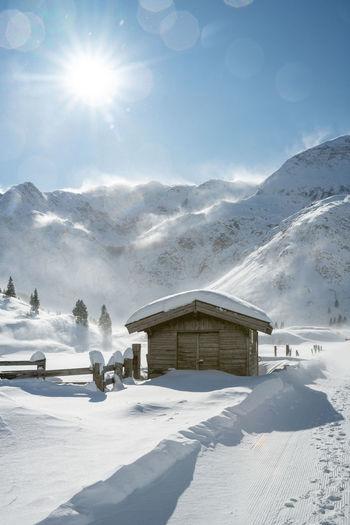 Wooden hut in winter wonderland in sportgastein ski resort, gastein, salzburg, austria