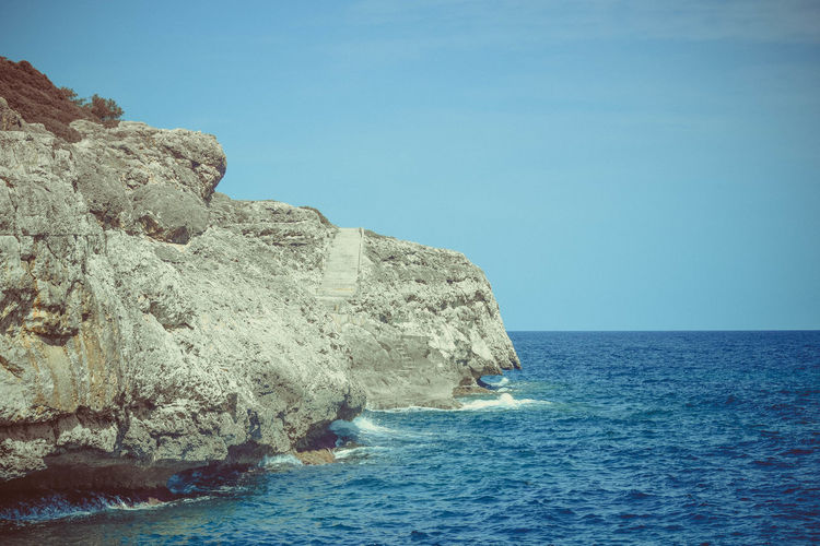 Sea Water Rock Sky Beauty In Nature Scenics - Nature Solid Horizon Over Water Rock - Object Horizon Waterfront Blue Rock Formation Nature Tranquil Scene Day Clear Sky Tranquility No People Outdoors Copy Space
