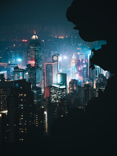 Silhouette of illuminated buildings at night