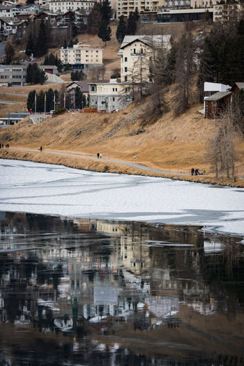 reflection of houses at lake st. moritz Graubünden Houses Ice Reflection Snow ❄ St. Moritz Winter Architecture Black Black Ice Built Structure Day Europe Lake Landscape Nature Outdoors Season  Snow Switzerland Water White Perspectives On Nature Shades Of Winter