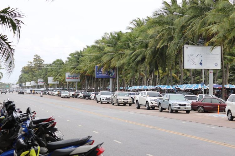 Bangsaen, Chonburi Thailand Beach Transportation Palm Tree Mode Of Transport Car Tree Day Land Vehicle Road Motorcycle Outdoors Sea Built Structure Sky No People Architecture Holiday