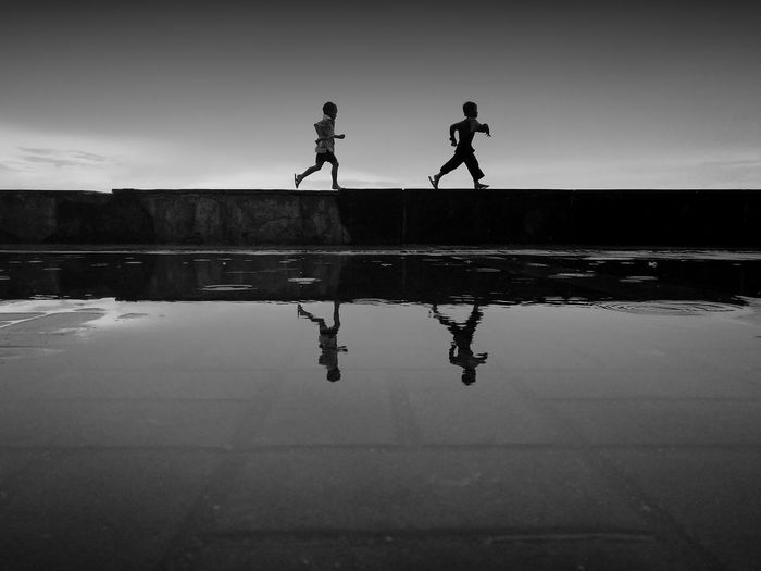 Double Run Kids Run Water Full Length Child Togetherness Friendship Men Lake Silhouette Boys Reflection