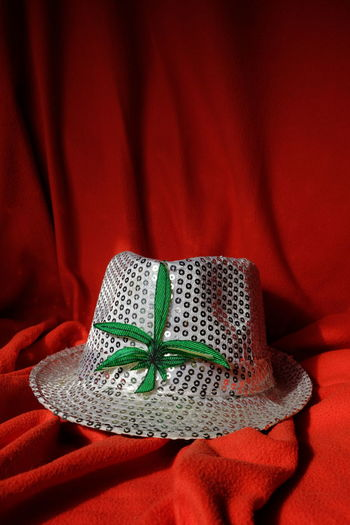 White hat on red textile