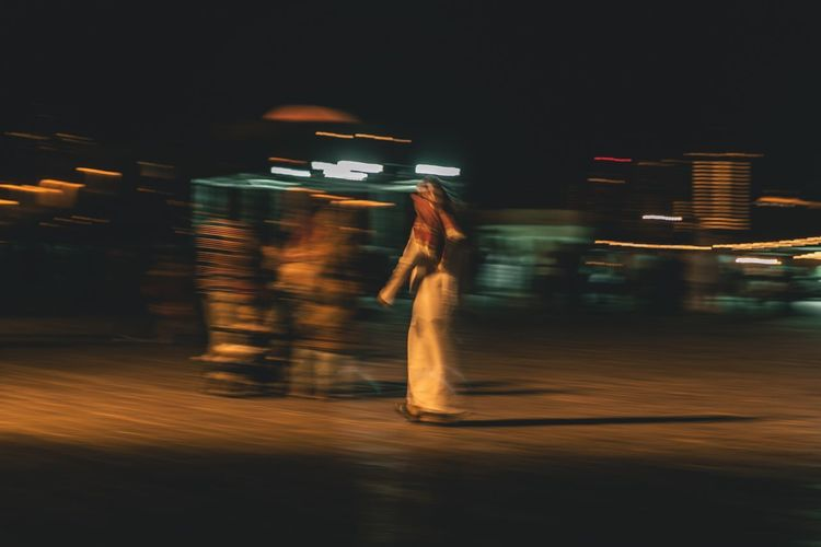 The ghost Arabian Walking One Man Blurred Motion Night Motion Transportation Illuminated Real People Mode Of Transportation One Person Leisure Activity City Lifestyles Street Speed Public Transportation Standing Land Vehicle Women Full Length Adult Outdoors