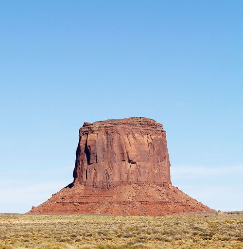 Arid Climate Barren Beauty In Nature Blue Clear Sky Day Desert Hill Horizon Over Land Landscape Low Angle View Mounment Valley Nature No People Non-urban Scene Outdoors Remote Rock Formation Scenics Sky Tourism Tranquil Scene Tranquility Travel Destinations USA