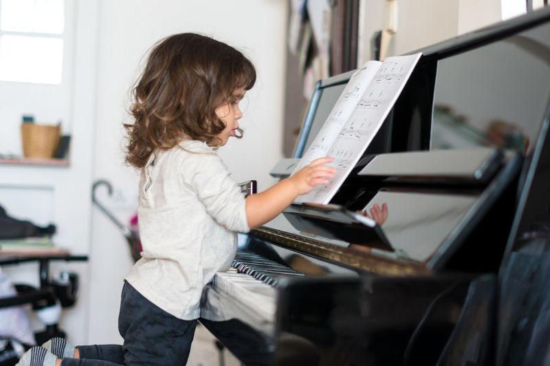 Girl Playing The Piano Childhood Music Musical Instrument Musical Note Musician Piano Playing Sheet Music EyeEmNewHere