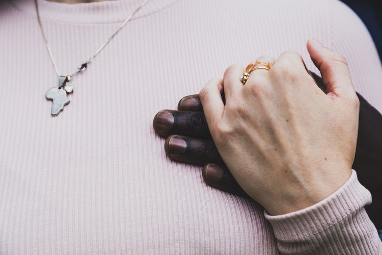 Multi-ethnic young couple's hands