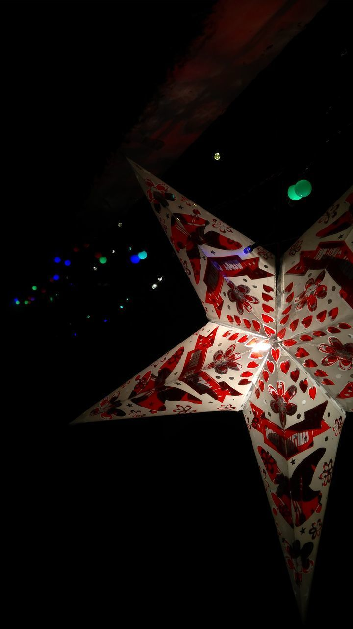 night, illuminated, indoors, no people, pattern, dark, decoration, close-up, lighting equipment, celebration, christmas, hanging, low angle view, multi colored, copy space, shape, holiday, glowing, star shape, black background, floral pattern